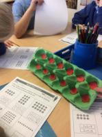 Spr 2: Arrays using egg boxes, counters and spot cards to develop understanding of multiplication.