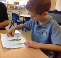 Aut 1: Christmas card artwork using finger prints in paint.