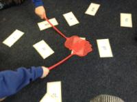 Aut 1: Learning to recognise yellow tricky words playing 'Splat Hands'.