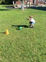Aut 1: Using two hands to aim and roll ball at cones. Improving hand/eye coordination.