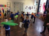 Aut 1: Using scarves to make circles linked to Maths 'shape' work.