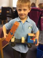 Aut 1: A moving working truck model. Able to describe tools used like drill and hinge. Discussed moving and fixed axles.