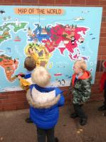 Aut 1: Exploring a map of the world in the playground.