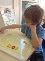 Aut 1: Rainbow Challenge - Making 'cvc' words with magnetic letters.