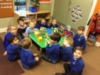 Aut 2: Using the small world play table to act out the Nativity.