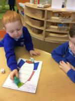 Aut 2: Maths games - moving counters while counting the correct number of spaces.