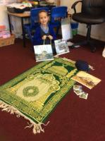 Spr 1: Pupil talked to Class 6 and 9 about being a Muslim. Showed Dad's prayer mat and beads and photos of different mosques.