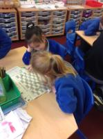 Spr 1: Playing snakes and ladders to practise the digraph 'aw' during Phonics sessions.