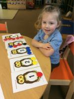 Spr 1: Recognised numbers 1 to 5, also able to count out the correct amount of buttons to match each number.