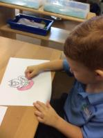 Spr 1: We drew the Cheshire Cat and used oil pastels to colour it in.