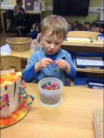 Spr 1: We threaded beads onto wire to decorate our 'Mad hatter's' hats.
