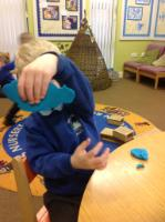 Spr 2: 'It's a sea cow, I watched it in Safari Adventure, it's long'. Working with playdough in continuous provision.