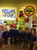 Spr 2: Our lollipop man came to talk about the importance of road safety and how he helps us cross the road safely.