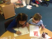 Sum 1: Exploring arrays, using counters and writing repeated addition calculations.