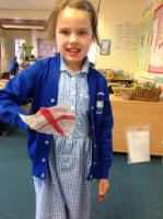 Sum 1: St. George shield made at home after learning about St.George's Day in circle time.
