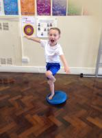 Sum 1:  Using the wobbleboard to improve balance.